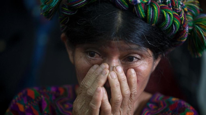 An Ixil Indian woman, the relative of a civil war victim, attends the genocide trial of former dictator Efrain Rios Montt in Guatemala City, Monday, Jan. 5, 2015. Rios Montt was forced to attend his trail for genocide after the court gave him an hour to present himself to the courtroom. His attorneys had alleged that he could not attend due to health reasons but the court rejected the appeal. (AP Photo/Moises Castillo)
