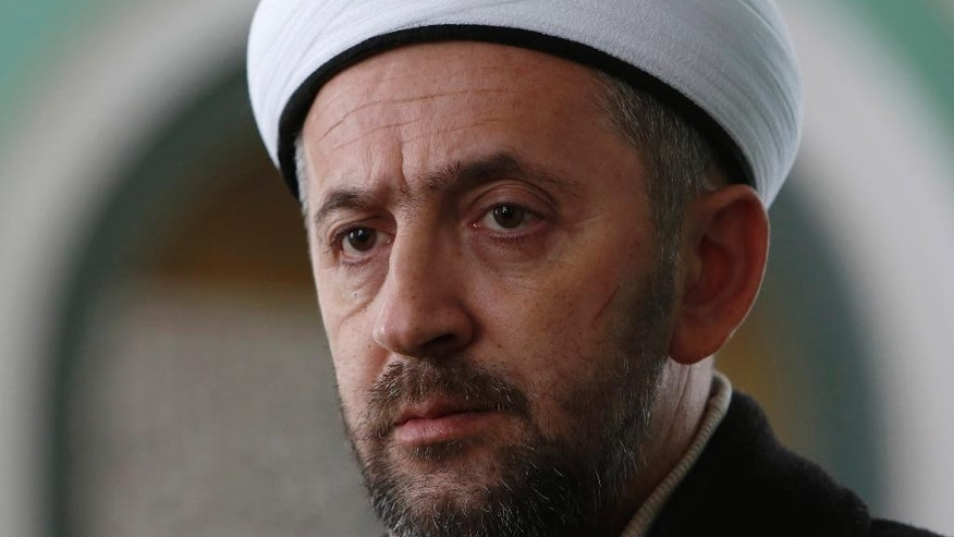 In this photo taken Saturday, Jan. 3, 2015, Bosnian imam Selvedin Beganovic, 44, pauses during an interview with The Associated Press at the mosque in the village of Trnovi, near Velika Kladusa, 370 kilometers (230 miles) northwest of Sarajevo, Bosnia. For Beganovic, his compatriots have no business fighting in Syria no matter how many times Muslim extremists try to kill him for saying so. The imam has suffered seven assaults blamed on Muslim extremists in the past year - with three just in the past month. (AP Photo/Amel Emric)