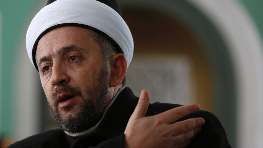 In this photo taken Saturday, Jan. 3, 2015, Bosnian imam Selvedin Beganovic, 44, speaks during an interview with The Associated Press at the mosque in the village of Trnovi, near Velika Kladusa, 370 kilometers (230 miles) northwest of Sarajevo, Bosnia.  For Beganovic, his compatriots have no business fighting in Syria no matter how many times Muslim extremists try to kill him for saying so. The imam has suffered seven assaults blamed on Muslim extremists in the past year - with three just in the past month. (AP Photo/Amel Emric)