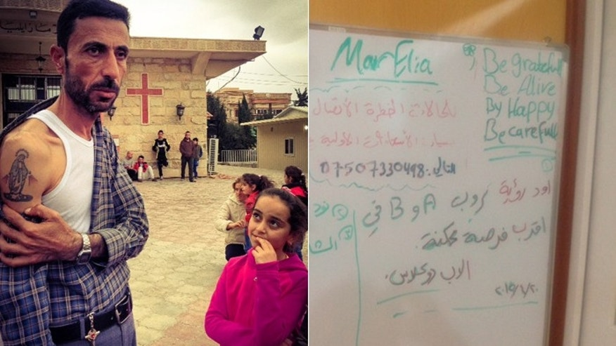 "One man living in a Christian tent village in Erbil displays a tattoo of the Virgin Mary, while a whiteboard message urges displaced kids to ""be grateful."" (FoxNews.com)"