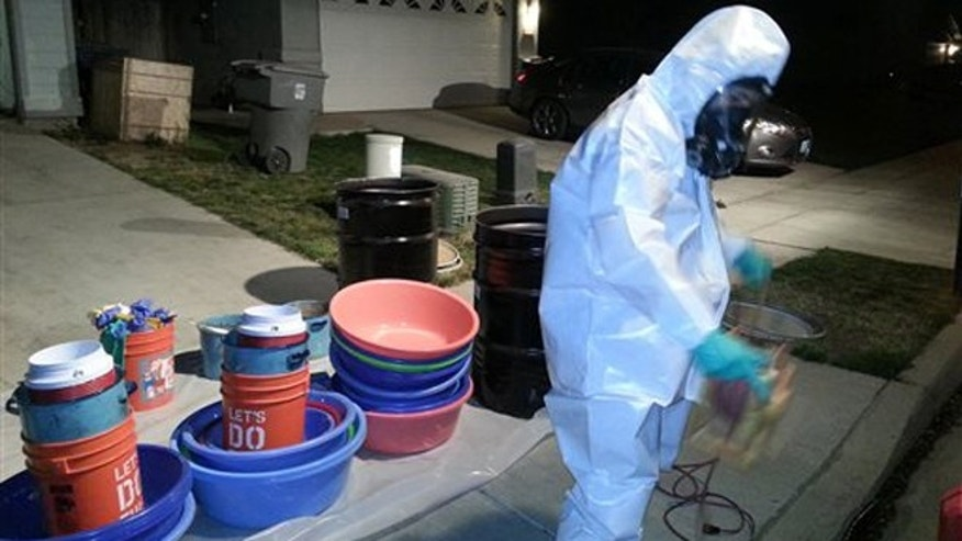 In this March 2014 photo provided by PARC Environmental, Jeff Davis, a hazardous materials specialist for PARC Environmental, cleans up a meth conversion lab inside a house in Madera, Calif. Authorities in Californiaâs Central Valley say that in recent years they have begun to see more meth dissolved as liquid and put into tequila bottles or plastic detergent containers to smuggle it across the border from Mexico. Once in the Central Valley, it is converted into crystals, itâs most sought-after form on the street. In the seedy underworld of methamphetamine, traffickers have turned to disguising the drug as a liquid to boost chances of smuggling it into the United States from Mexico without getting caught.(AP Photo/PARC Environmental)