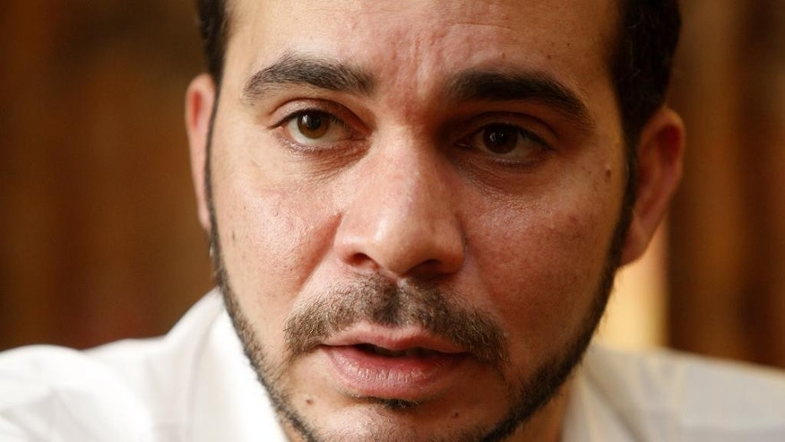 FILE - In this Wednesday, March 21, 2012 file photo, FIFA Vice President Prince Ali Bin Al Hussein speaks during an interview with The Associated Press in Kuala Lumpur, Malaysia. Ali Bin Al Hussein of Jordan will stand for election in a bid to oust Sepp Blatter as leader of football's scandal-hit world governing body. (AP Photo/Lai Seng Sin, File)