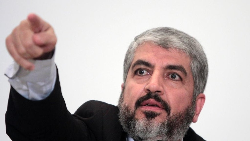 FILE - In this Sept. 28, 2009 file photo, Khaled Meshaal, head of Hamas Politburo in Damascus, talks during a presser following his talks with Egyptian officials  in Cairo, Egypt.  The Hamas militant group is denying claims Tuesday, Jan. 6, 2015 that its exiled leader, Khaled Mashaal, has been expelled from his base in Qatar. (AP Photo/Amr Nabil, File)