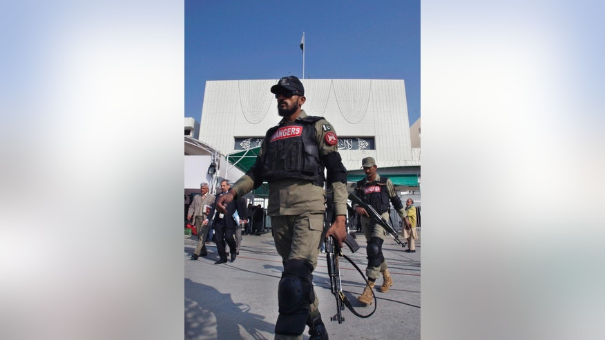 Pakistani paramilitary soldiers patrol at the premises of National Assembly building during an assembly session Tuesday, Jan. 6, 2015 in Islamabad, Pakistan, Tuesday, Jan. 6, 2015. Pakistan's lower house has passed constitutional amendment bill tabled by the government in the parliament to form special military courts for trial of terrorists. (AP Photo/Anjum Naveed)