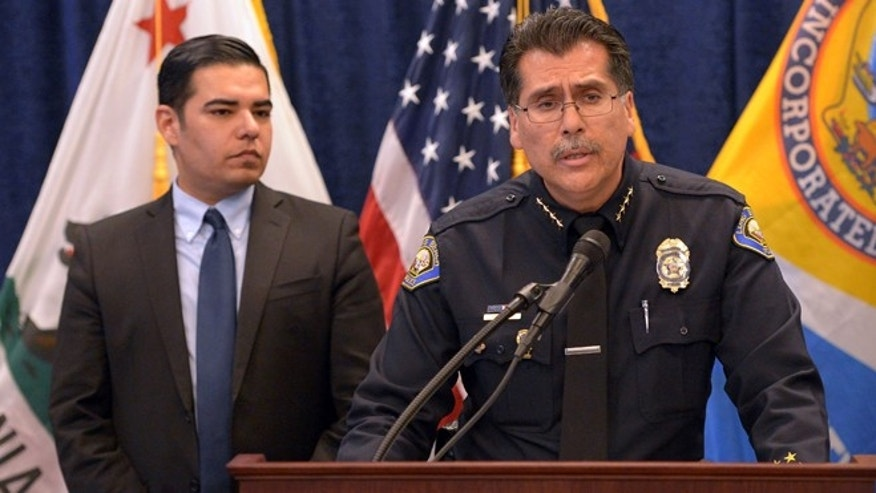 With Long Beach Mayor Robert Garcia standing next to him at left, police Chief Robert Luna pleads with the public for information in the death of a 3-week-old baby girl at a press conference in Long Beach,  Calif., on Monday, Jan. 5, 2015. Eliza Delacruz was kidnapped over the weekend and found dead in a dumpster behind a shopping center in San Diego County. The baby's mother, father and uncle were all shot and wounded in the kidnapping. (AP Photo/The Daily Breeze, Scott Varley)