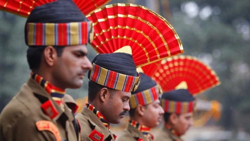 Indian Border Security Force (BSF) soldiers pay homage to their colleague who was killed in an India-Pakistan cross-border firing, in Jammu, India, Tuesday, Jan. 6, 2015. Pakistani troops fired gunshots and mortar shells that killed the Indian soldier in northern Kashmir on Monday after a lull in the countries' cross-border firing, an Indian paramilitary official said. Pakistan blamed India for the violence and said two civilians were killed by Indian shelling. (AP Photo/Channi Anand)