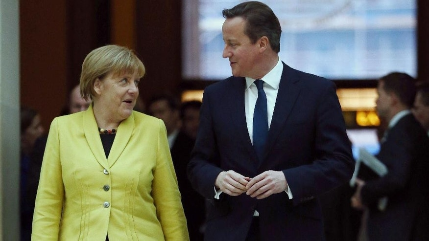 German Chancellor Angela Merkel, left walks with British Prime Minister David Cameron at the British Museum during Merkel's visit to the capital, in London, Wednesday, Jan. 7, 2015. The German leader is in London for talks, and Cameron is hoping she'll support his plan to keep the U.K. within a reformed European Union. (AP Photo/ Dan Kitwood, Pool)