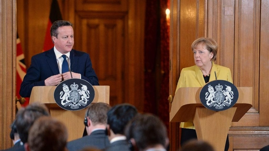 German Chancellor Angela Merkel, right, speaks during a joint news conference with British Prime Minister David Cameron following their talks at 10 Downing Street, London, Wednesday, Jan. 7, 2015. Cameron and Merkel expressed their condolences and support to French President Francois Hollande after the deadly gun attack on satirical newspaper Charlie Hebdo. (AP Photo/John Stillwell, Pool)