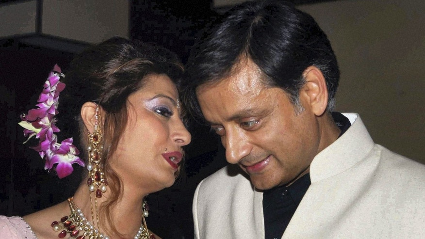 Sept. 4, 2010: Former Indian Junior Foreign Minister Shashi Tharoor listens to his wife Sunanda Pushkar at their wedding reception in New Delhi, India