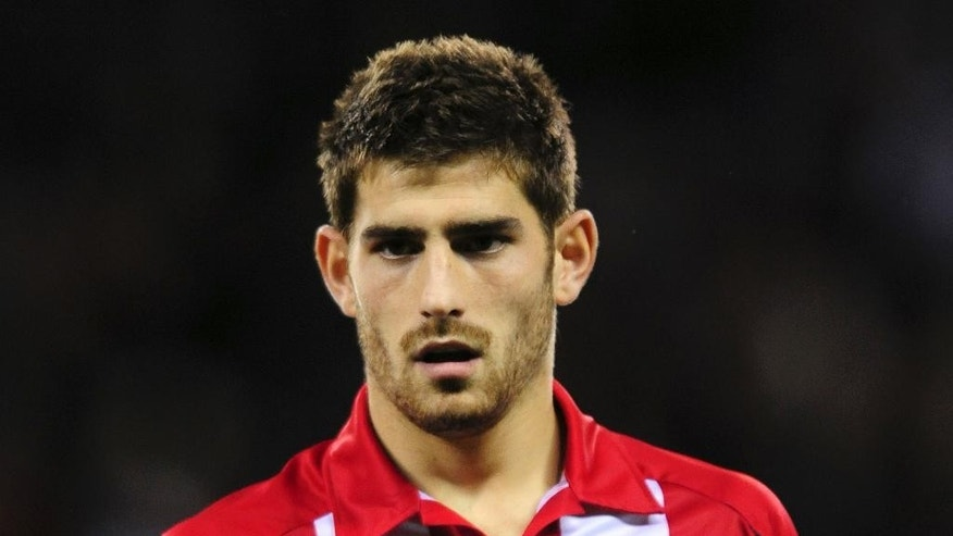 FILE - This is a Nov. 2, 2009 file photo of  British soccer player Ched Evans.  Evan's is an  experienced soccer player and wants to play _ but it's beginning to look as if public opinion in Britain may prevent forward Ched Evans from ever resuming his professional soccer career. Evans, 26, is out on probation after serving prison time for raping a 19-year-old in his hotel room in 2011.  Yet public reaction to his possible return to the nation's favorite sport is becoming more and more vehement. (AP Photo'Anna Gowthorpe/PA, File) UNITED KINGDOM OUT
