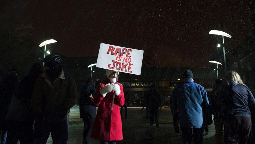 Protestors gather outside the Centre in the Square theater in Kitchener, Ontario, Canada on Wednesday, Jan. 7, 2015 to protest a performance by Bill Cosby. This is the first of three Ontario shows amid brewing tensions and mounting allegations of sexual assault by the comedian. (AP Photo/The Canadian Press, Hannah Yoon)