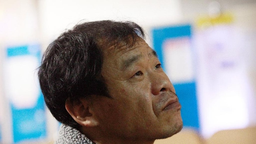 In this Feb. 19, 2014 photo, former salt farm worker Lee Hyang-gyun ponders during an interview in Mokpo, South Korea.  Lee was freed from slavery in 2006, but he still finds himself consumed by anger and resentment. He was 15 when two men grabbed him at a train station in a port town in southern South Korea and sold him to a rice farmer on an island near Sinui. For the next 18 years he was slave. (AP Photo/Ahn Young-joon)