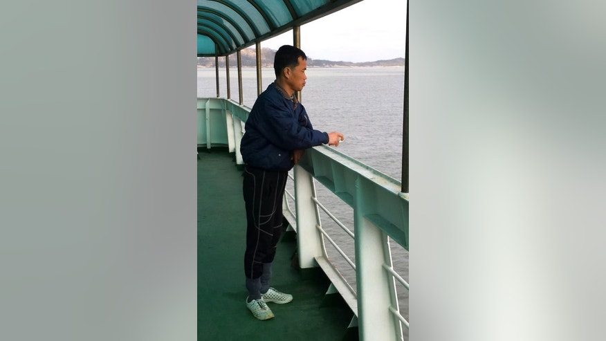 FILE - In this Jan. 24, 2014 file image taken from a video footage released by Guro Police,  Kim Seong-baek stands on the deck of a boat leaving Sinui Island, South Korea.  Kim, freed South Korean salt-farm slave appeared in court Wednesday, Jan. 7, 2015,  to confront his former boss. Another, sick of life in a homeless shelter, has been considering his one-time owner's request that he come back. They are among dozens of disabled men liberated in the past year from salt farms on remote islands in southwestern South Korea where a months-long investigation by The Associated Press found that slavery still thrives, an open secret among locals and neglected by officials.  (AP Photo/Guro Police, File)