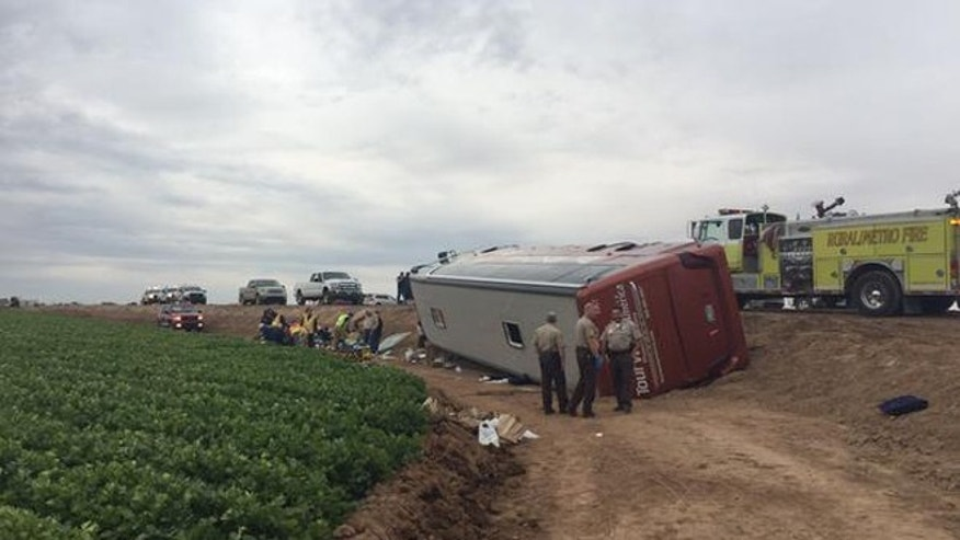 Scene of a tour bus that rolled over in Yuma, Ariz., on Thursday, Jan. 8, 2015.