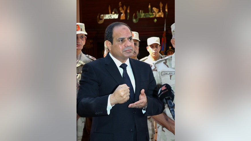 "FILE - In this Oct. 25, 2014, file photo provided by Egypt's state news agency MENA, Egyptian President Abdel-Fattah el-Sissi speaks ahead of a military funeral for troops killed in an assault in the Sinai Peninsula, as he stands with army commanders in Cairo, Egypt. El-Sissi opened 2015 with a dramatic call for a ""revolution"" in Islam and for reform of interpretations of the faith entrenched for hundreds of years. His professed goal is to purge the religion of extremist ideas of intolerance and violence that fuel groups like al-Qaida and the Islamic State - and lie behind Tuesday's attack in Paris on a French satirical newspaper that killed 12 people. (AP Photo/MENA, Mohammed Samaha, File)"