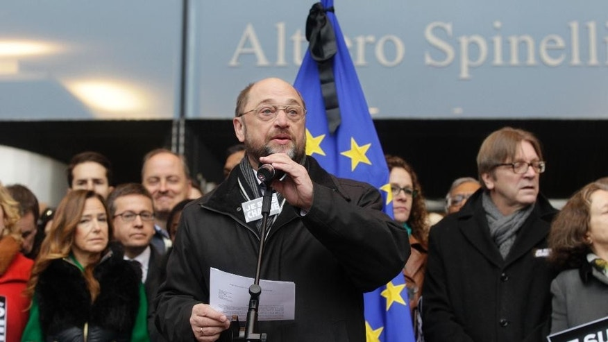 European Parliament President Martin Schulz addresses bystanders during a gathering to pay respect to the victims of Wednesday's terror attack in Paris, in front of the European Parliament in Brussels, Thursday, Jan. 8, 2015. Eight journalists, two police officers, a maintenance worker and a visitor were killed, and eleven people wounded in a terrorist attack against French satirical newspaper Charlie Hebdo in Paris. (AP Photo/Yves Logghe)