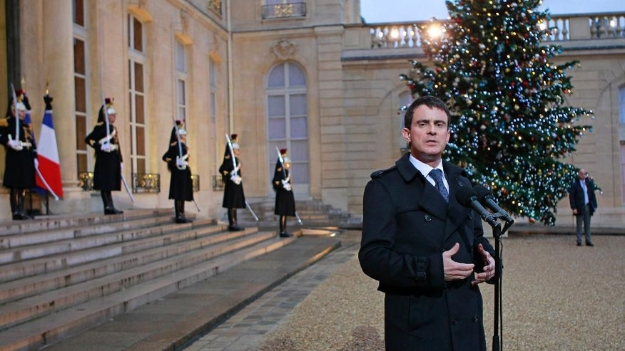 "French Prime Minister Manuel Valls addresses reporters following a crisis meeting with French President Francois Hollande at the Elysee Palace in Paris Thursday, Jan. 8, 2015. Police hunted Thursday for two heavily armed men, one with possible links to al-Qaida, in the methodical killing of 12 people at a satirical newspaper that caricatured the Prophet Muhammed. Valls said the possibility of a new attack ""is our main concern"" and announced several overnight arrests. (AP Photo/Remy de la Mauviniere)"