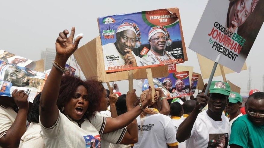 Supporters of Nigeria President Goodluck Jonathan shout slogans, during an election campaign rally, at Tafawa Balewa Square in Lagos, Nigeria, Thursday, Jan. 8, 2015. The president launches his bid for re-election at a time when Africa's biggest oil producer is more divided than ever, amid a growing Islamic uprising in the northeast and slumping oil prices and the naira currency biting into people's pockets. (AP Photo/Sunday Alamba)