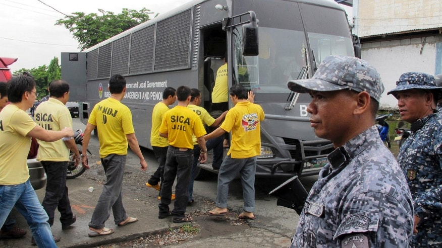 July 15, 2013:  Muslim detainees board their bus to take them back to their detention following one of the reinvestigation hearings to review their cases at the the special court near their detention compound at Camp Bagong Diwa.