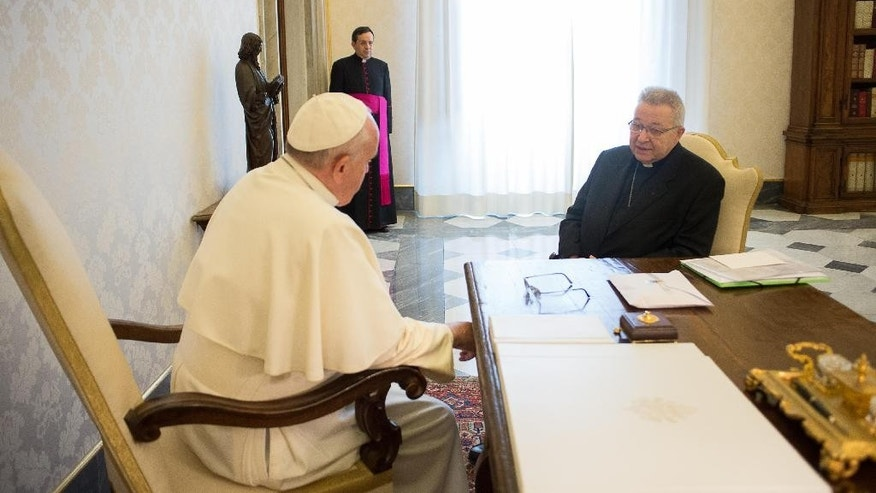 """Pope Francis meets Archbishop of Paris, Cardinal André Vingt-Trois, during a private audience at the Vatican, Thursday, Jan. 8, 2015. Pope Francis has celebrated a Mass in memory of the victims of the Charlie Hebdo massacre, decrying the """"human cruelty"""" that people are capable of. Francis asked for prayers for the victims at the start of Mass and said """"we also ask for those who are cruel so that the Lord may change their heart."""" (AP Photo/L'Osservatore Romano, Pool)"""