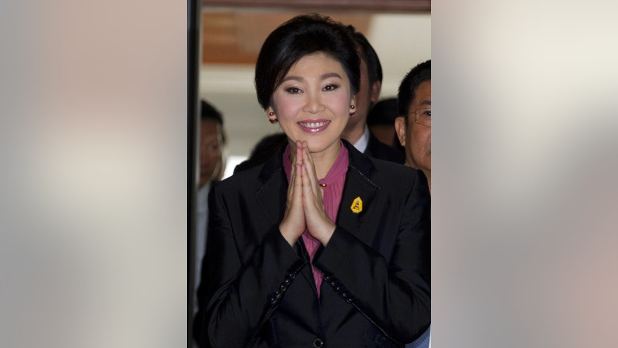 Thailand's former Prime Minister Yingluck Shinawatra arrives at parliament in Bangkok, Thailand Friday, Jan. 9, 2015. Thailand's military-appointed legislature will start an impeachment hearing Friday against Yingluck, a move analysts say is aimed at ensuring the ousted leader stays out of politics for the foreseeable future. (AP Photo/Sakchai Lalit)