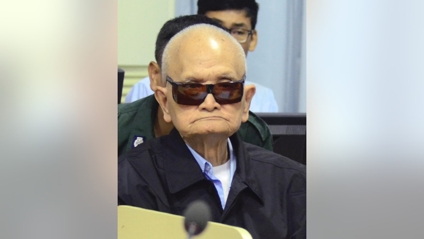 In this photo released by the Extraordinary Chambers in the Courts of Cambodia, Nuon Chea, who was the Khmer Rouge's chief ideologist and No. 2 leader sits in a court room of the U.N.-backed war crimes tribunal, in Phnom Penh, Cambodia, Thursday, Jan. 8, 2015. The U.N.-backed war crimes tribunal on Thursday began its evidence hearing in the second trial against the two most senior surviving leaders of the Khmer Rouge regime, Khieu Samphan, former Khmer Rouge head of state, and Nuon Chea, who was the Khmer Rouge's chief ideologist and second in-command. The two octogenarians are facing charges of genocide, war crimes and crimes against humanity. (AP Photo/Extraordinary Chambers in the Courts of Cambodia, Nhet Sok Heng)