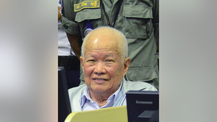 In this photo released by the Extraordinary Chambers in the Courts of Cambodia, Khieu Samphan, former Khmer Rouge head of state, sits in a court room of the U.N.-backed war crimes tribunal, in Phnom Penh, Cambodia, Thursday, Jan. 8, 2015. The The U.N.-backed war crimes tribunal on Thursday began its evidence hearing in the second trial against the two most senior surviving leaders of the Khmer Rouge regime, Khieu Samphan, former Khmer Rouge head of state, and Nuon Chea, who was the Khmer Rouge's chief ideologist and second in-command. The two octogenarians are facing charges of genocide, war crimes and crimes against humanity. (AP Photo/Extraordinary Chambers in the Courts of Cambodia, Nhet Sok Heng)