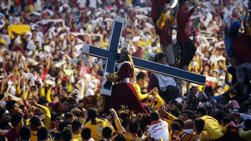 Jan. 9, 2015: Filipino devotees carry the image of the Black Nazarene for its annual procession to celebrate its feast day.
