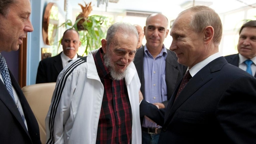 FILE - In this July 11, 2014 file photo, Cuba's Fidel Castro, center, visits with Russia's President Vladimir Putin, right, in Havana, Cuba. Social media around the world have been flooded with rumors of Castro's death, but there was no sign Friday, Jan. 9, 2015, that the reports were true, even if the 88-year-old former Cuban leader has not been seen in public for months. (AP Photo/Alex Castro, File)