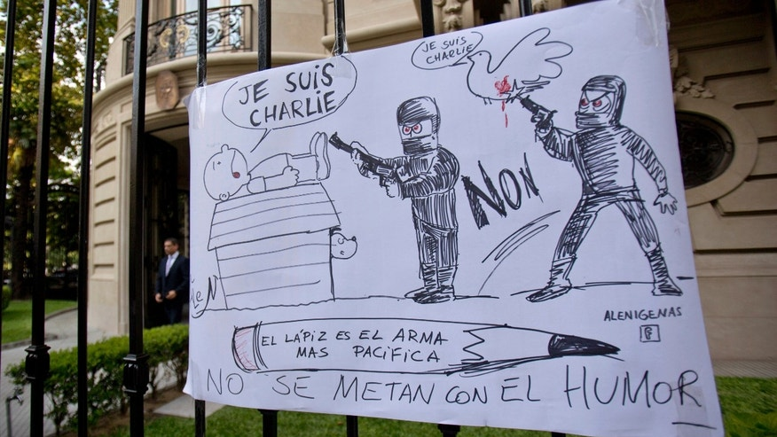 "A cartoon style drawing hangs outside France's embassy that reads in Spanish ""The pencil is the most peaceful weapon, don't mess with humor"" in solidarity with those killed in an attack at the Paris offices of the weekly newspaper Charlie Hebdo in Buenos Aires, Argentina, Wednesday, Jan. 7, 2015. Masked gunmen stormed the offices of the satirical newspaper that caricatured the Prophet Muhammad, methodically killing 12 people Wednesday, including the editor, before escaping in a car. It was France's deadliest postwar terrorist attack. (AP Photo/Natacha Pisarenko)"