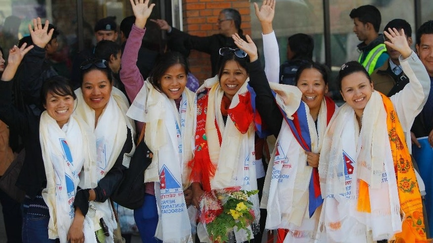 Jan. 9, 2015: From left to right: Nepalese climbers Nimdoma Sherpa, Maya Gurung, Asha Singh, Chunu Shrestha, Pema Dikki and Shailee Basnet pose for the media at the Tribhuwan International Airport, Kathmandu.