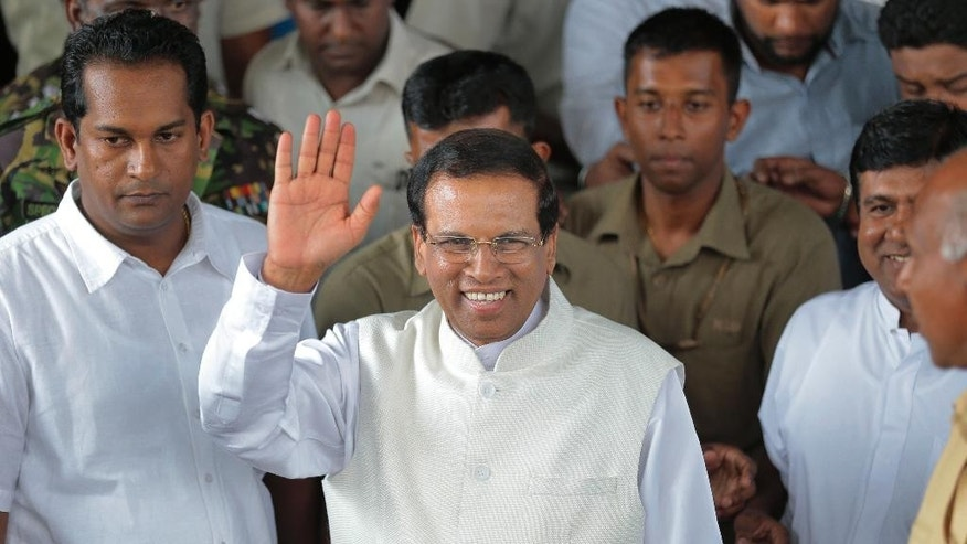 Sri Lanka incoming President Maithripala Sirisena waves to supporters as he leaves the election secretariat in Colombo, Sri Lanka, Friday, Jan. 9, 2015.  In a stunning election result that was unthinkable just weeks ago, Sri Lanka's longtime president acknowledged Friday that he had been defeated by a onetime political ally, signaling the fall of a family dynasty and the rise of former Cabinet minister Sirisena. (AP Photo/Eranga Jayawardena)