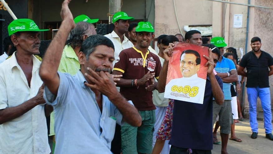 Supporters of Sri Lanka's main opposition presidential candidate Maithripala Sirisena celebrates at the end of voting in the presidential election in Colombo, Sri Lanka, Thursday, Jan. 8, 2015. The November defection by former Health Minister Sirisena turned the race, which President Mahinda Rajapaksa had been widely expected to easily win, into a referendum on the president and the enormous power he wields over the island nation of 21 million. (AP Photo/Eranga Jayawardena)