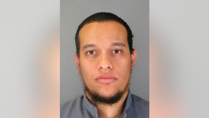 This photo provided by The Paris Police Prefecture Thursday, Jan. 8, 2015 shows the suspect Said Kouachi in the newspaper attack along with a plea for witnesses. A senior Yemeni official said Friday, Jan. 9, 2015 that Said Kouachi, a suspect in the attack on the French newspaper, is suspected of fighting in Yemen for al-Qaida.(AP Photo/Prefecture de Police de Paris)