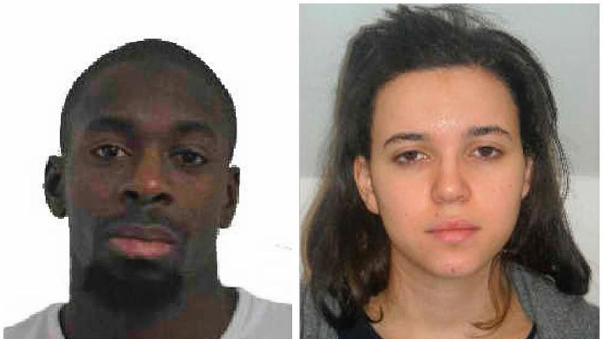CORRECTS FIRST NAME OF FEMALE SUSPECT  In this combination photo provided by the Paris Police Prefecture, Amedy Coulibaly, left, and Hayat Boumddiene, two suspects named by police as accomplices in a kosher market attack on the eastern edges of Paris on Friday, Jan. 9, 2015. A police official says the man who has taken at least five people hostage in a kosher market on the eastern edges of Paris Friday appears linked to the newsroom massacre earlier this week that left 12 people dead. Paris police released a photo of Amedy Coulibaly as a suspect in the killing Thursday of a policewoman, and the official named him as the man holed up in the market. He said the man is armed with an automatic rifle and some hostages have been gravely wounded. He said a second suspect, a woman named Hayat Boumddiene, is the gunman's accomplice. (AP Photo/Prefecture de Police de Paris)
