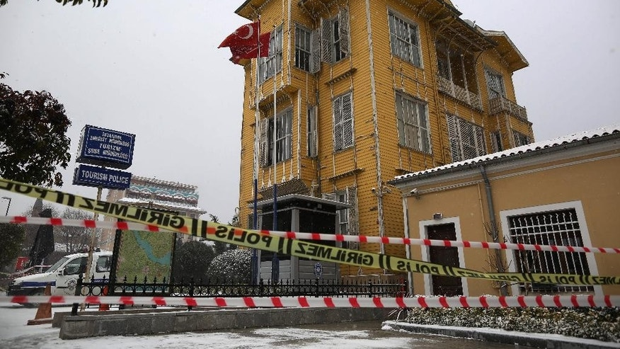 The police station is seen a day after a policeman was killed and another injured when a female suicide bomber blew herself up in Istanbul, Turkey, Wednesday, Jan. 7, 2015. Istanbul governor Vasip Sahin said the woman entered a police station and reported a missing wallet before detonating a bomb. The attack occurred in the Sultan Ahmet district, a popular tourist destination.(AP Photo/Emrah Gurel)