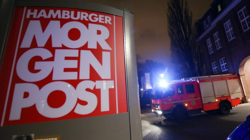 Jan. 11, 2015: A firef truck sits outside the building of the 'Hamburger Morgenpost' in Hamburg, northern Germany.