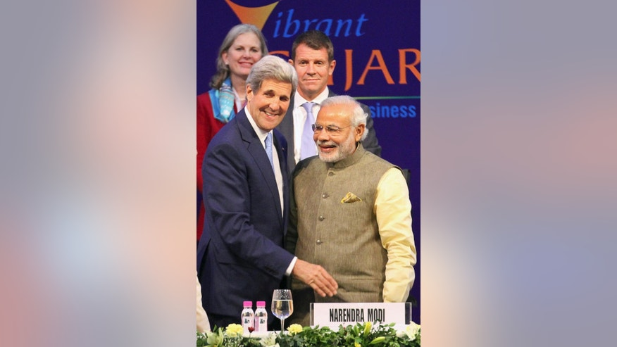 U.S. Secretary of State John Kerry, left, and Indian Prime Minister Narendra Modi attend the Vibrant Gujarat summit in Gandhinagar, India, Sunday, Jan. 11, 2015. Kerry is in India to attend an international investment conference and push trade ties with the giant South Asian nation ahead of visit by President Barack Obama later this month. (AP Photo/Ajit Solanki)