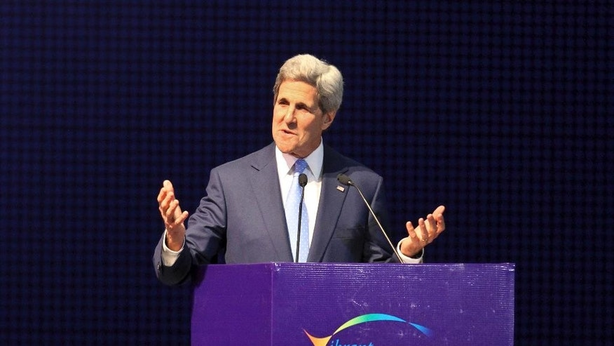 U.S. Secretary of State John Kerry speaks at the Vibrant Gujarat summit in Gandhinagar, India, Sunday, Jan. 11, 2015. Kerry is in India to attend an international investment conference and push trade ties with the giant South Asian nation ahead of visit by President Barack Obama later this month. (AP Photo/Ajit Solanki)
