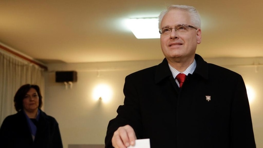 Incumbent Ivo Josipovic casts his ballot at a polling station in Zagreb, Croatia, Sunday, Jan. 11, 2015. A liberal incumbent and a conservative rival are heading into a surprisingly close showdown in Croatia's presidential runoff held amid deep discontent over economic woes in the European Union's newest member. (AP Photo/Darko Bandic)