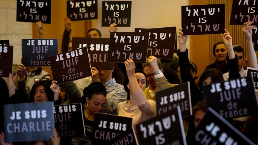 "Jan. 11, 2015: Israelis, mostly French Jews, hold signs that read, ""I am Charlie,"" ""Israel is Charlie"" and ""I am a Jew of France"" during a gathering in the municipality in Jerusalem, Sunday."
