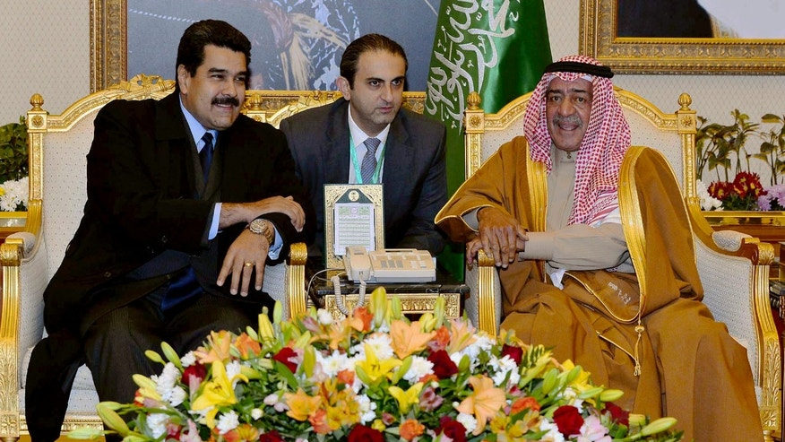 In this photo released by Saudi Press Agency, Deputy Crown Prince of Saudi Arabia, Prince Muqrin bin Abdulaziz Al Saud, right, receives Venezuelan President Nicolas Maduro in Riyadh, Saudi Arabia, Sunday, Jan. 11, 2015. (AP Photo/SPA)