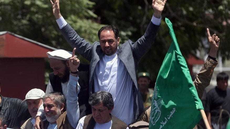 In this June 27, 2014 photo, Afghan politician Salahuddin Rabbani, participates in a rally, in Kabul, Afghanistan. The Afghan government has announced its full list of Cabinet nominees after months of delays and missed deadlines. Rabbani, the former head of the country's high peace council, has been nominated for foreign minister in Afghanistan's new cabinet. All cabinet nominees must now receive approval from the parliament. (AP Photo/Massoud Hossaini)