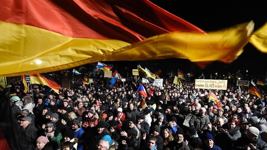 Demonstrators bear flags of several European countries during a rally of the group Patriotic Europeans against the Islamization of the West, or PEGIDA, in Dresden, Germany, Monday, Jan. 12, 2015. (AP Photo/Jens Meyer)