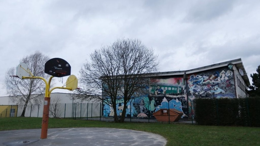 The Friday, Jan. 9, 2015 photo shows a playground next to a gymnasium that used hold shelter to 17 refugees from North Africa in the town of Grossroehrsdorf, eastern Germany. When 17 refugees from North Africa arrived in this once-prosperous textile town shortly before Christmas many Grossroehrsdorfers didn't want the foreigners living in their midst. Within days, authorities caved to pressure and moved the young men elsewhere. (AP Photo/Petr David Josek)