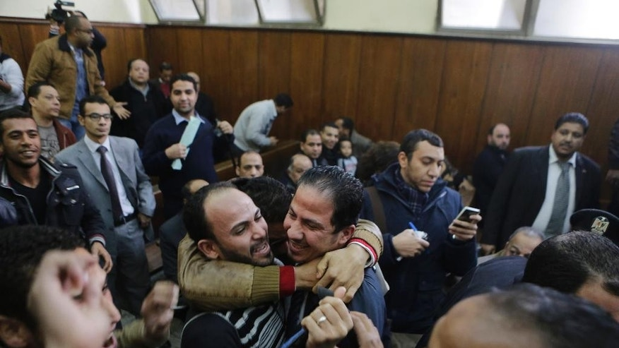 Relatives of 26 men who were arrested in a televised raid last month by police looking for gays at a Cairo public bathhouse, celebrate after an Egyptian court acquitted them in Cairo, Egypt, Monday, Jan. 12, 2015. The trial, which had caused an uproar among activists and rights groups, captured public attention after a pro-government TV network aired scenes of half-naked men being pulled from the bathhouse by police.(AP Photo/Amr Nabil)