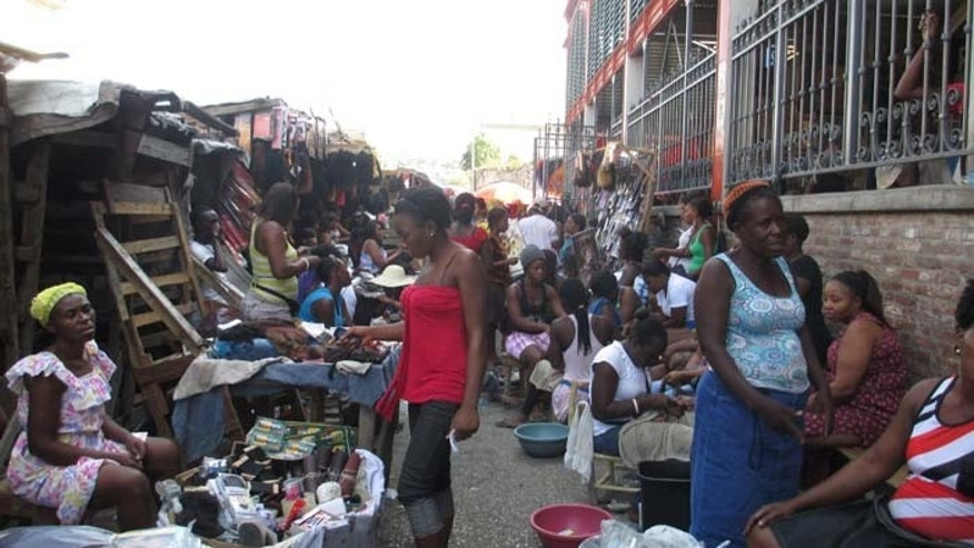 Haitians gather in the capital's downtown, where signs of economic life have begun to appear. (FoxNews.com)