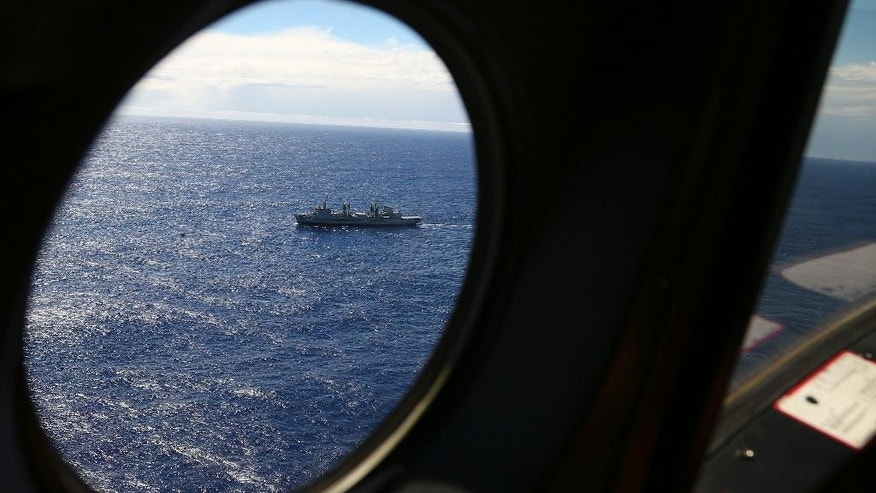 In this March 31, 2014 file photo, HMAS Success sails as a Royal New Zealand Air Force P3 Orion flies past while searching for missing Malaysia Airlines Flight 370 in the southern Indian Ocean, near the coast of Western Australia. A fourth ship with specialized underwater sonar equipment will join the search for the Malaysia Airlines jet 10 months after it vanished under mysterious circumstances off the west coast of Australia, an official said Monday, Jan. 12, 2015. The ship Fugro Supporter was on its way to the search area after conducting trials off the Indonesian island of Bali, Australian Deputy Prime Minister Warren Truss said in a statement. (AP Photo/Rob Griffith, File)