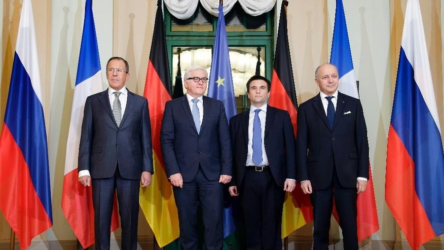 German Foreign Minister Frank-Walter Steinmeier, second left, welcomes his counterparts from France, Laurent Fabius, right, Russia, Sergey Lavrov, left, and Ukraine, Pavlo Klimkin, second right, for a meeting on the situation in Ukraine in Berlin, Germany, Monday, Jan. 12, 2015. (AP Photo/Michael Sohn, pool)
