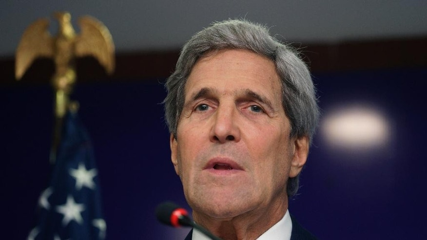 U.S. Secretary of State John Kerry speaks at a press conference in Gandhinagar, India, Monday, Jan. 12, 2015. Kerry said he will travel to Paris this week for talks on countering extremist violence, following sharp criticism of the Obama administration for not sending a senior official to Sunday's rally for unity in Paris that was attended by some 40 world leaders and more than a million people. (AP PhotoRick Wilking, Pool)